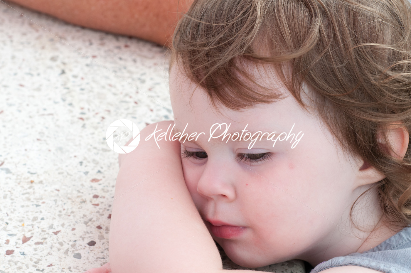 Cute young toddler girl falling asleep resting her head on table - Kelleher Photography Store