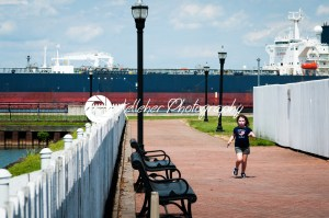DELAWARE CITY, DE – AUGUST 1: Oil tanker ship coming into port on Delware river on a background of blue sky on August 1, 2015 - Kelleher Photography Store