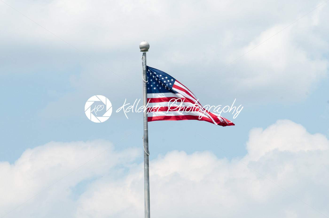 Flag of the United States of America with blue sky and clouds behind it - Kelleher Photography Store