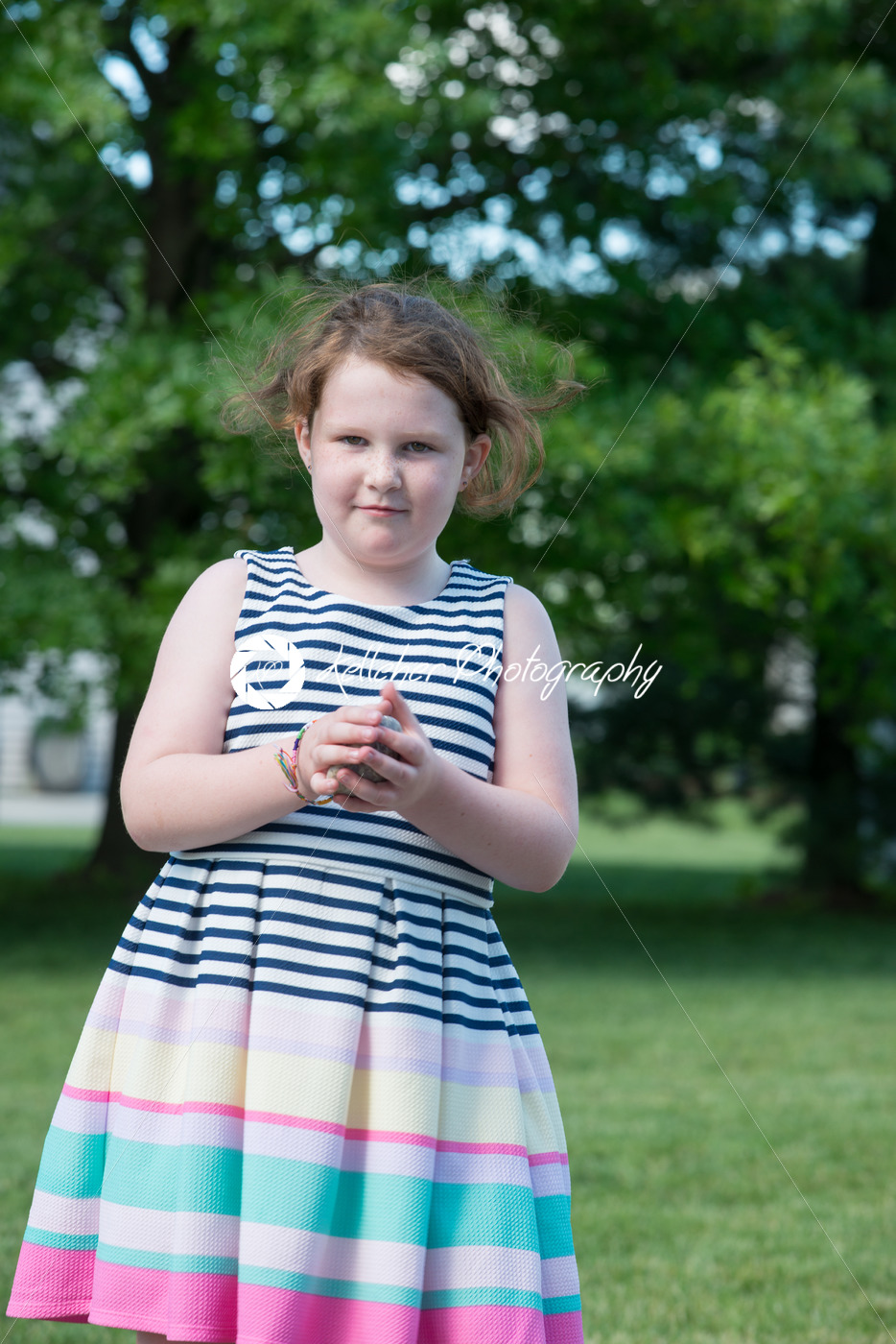 Portrait of Young Girl Standing in Backyard - Kelleher Photography Store