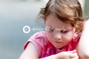 Portrait of young girl at sunset sitting down - Kelleher Photography Store