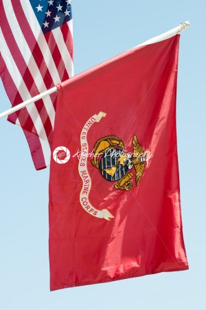United States Marine Corps flag waving on blue sky background, close up, with American flag in background - Kelleher Photography Store