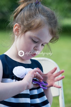 Young Girl Playing with Fidget Hand Spinner - Kelleher Photography Store