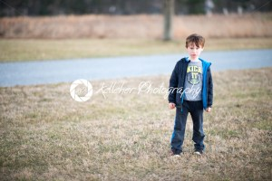 young boy outside pouting and angry at sunset golden hour - Kelleher Photography Store