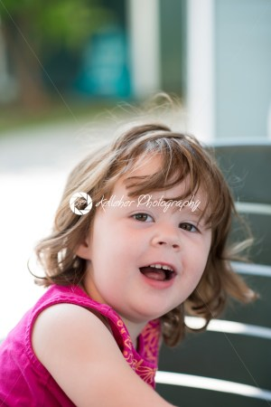 young little girl sitting down and looking happy - Kelleher Photography Store