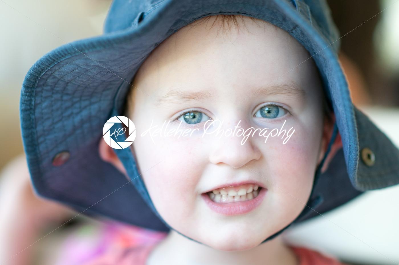 Cute boy wearing a hat outside - Kelleher Photography Store