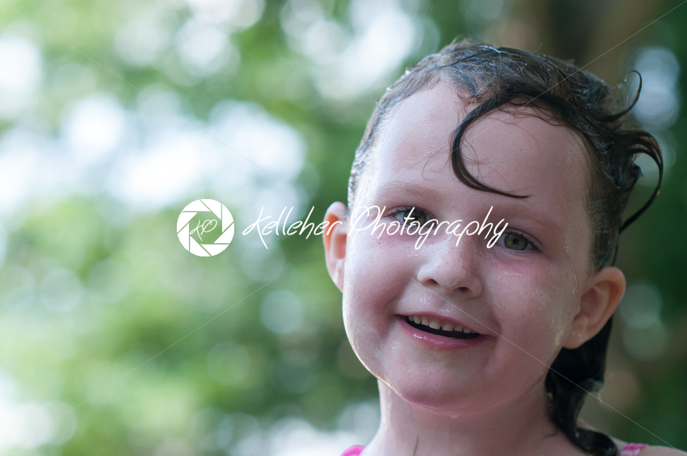 Little girl outside with wet hair after swimming - Kelleher Photography Store