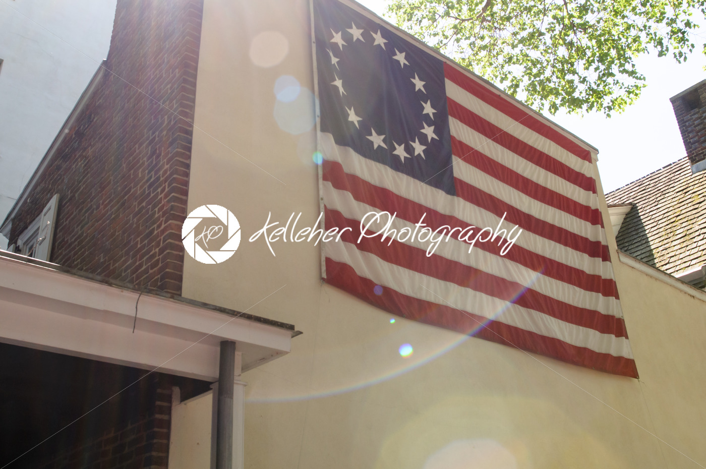 PHILADELPHIA, PA – MAY 14: American thirteen point historic flag often named the Betsy Ross flag, in front of the Betsy Ross House at 239 Arch Street on May 14, 2015 - Kelleher Photography Store