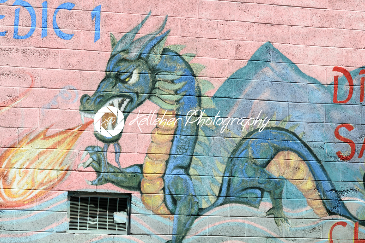 PHILADELPHIA, PA – MAY 14: Fire breathing dragon graffti artwork mural in the Chinatown section of downtown Philadelphia on May 14, 2015 - Kelleher Photography Store