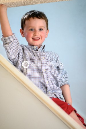 Portrait of a cute little boy inside on stairs - Kelleher Photography Store