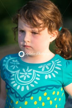 Portrait of beautiful attractive young girl thinking outside at sunset - Kelleher Photography Store