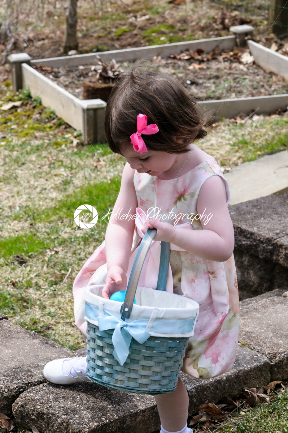 Young Girl Outside Dressed Up for Easter holding Basket - Kelleher Photography Store