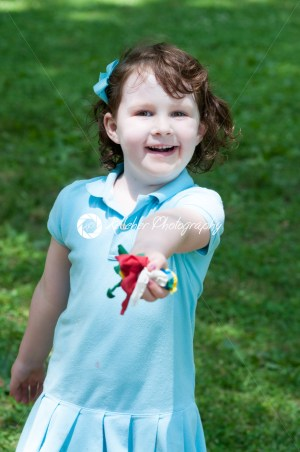 Young girl outside at park holding balloons - Kelleher Photography Store