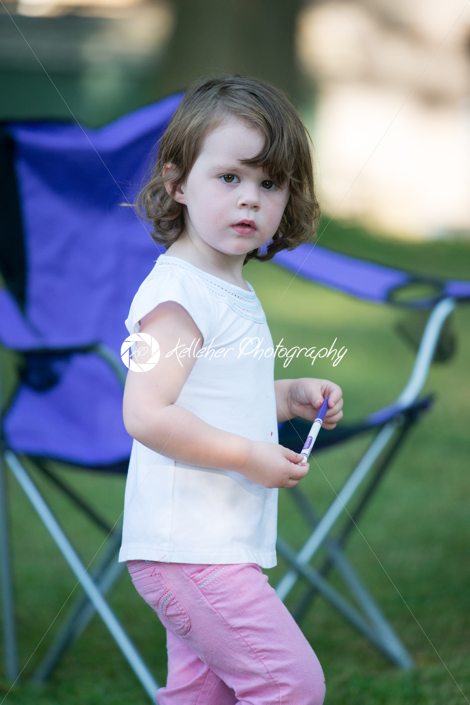 Young girl outside coloring with markers - Kelleher Photography Store