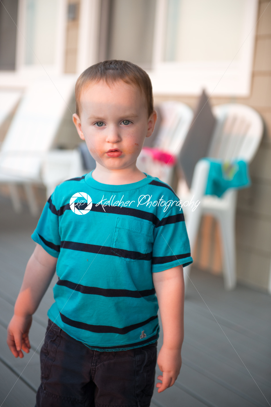Young toddler boy on patio deck outside at sunset down at shore - Kelleher Photography Store