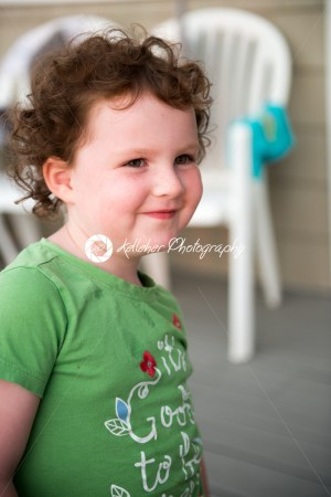 Young toddler girl on patio deck outside at sunset down at shore - Kelleher Photography Store