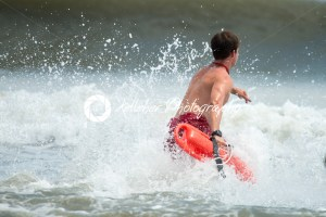 MARGATE CITY, NJ – AUGUST 8: Margate City Lifeguard running into the Atlantic Ocean to rescue a swimmer in distress - Kelleher Photography Store