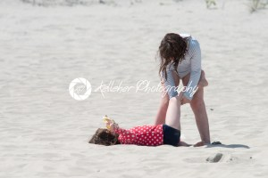 Sibling girls playing in the sand on summer beach - Kelleher Photography Store