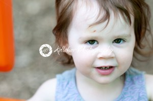 Portrait of a happy liitle girl close-up - Kelleher Photography Store