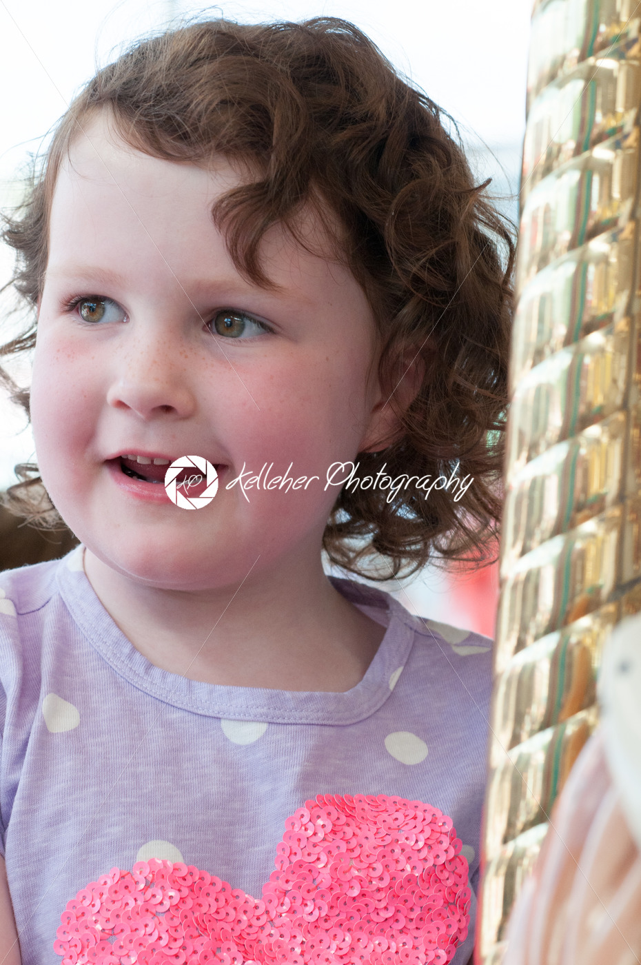 Young girl riding on fairground horse on carousel amusement ride at fairgrounds park outdoor - Kelleher Photography Store