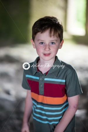 Young little boy portrait looking around inside castle - Kelleher Photography Store