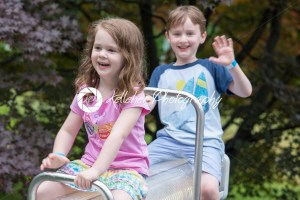 Happy brother and sister playing in park - Kelleher Photography Store