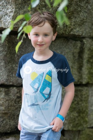 Smiling young boy standing outdoors - Kelleher Photography Store