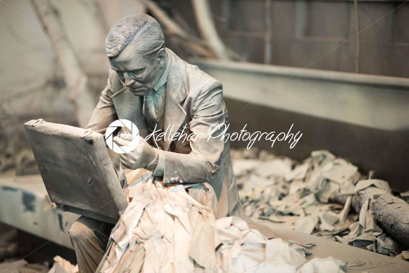 TRENTON, NJ – JUNE 17, 2017: Business man sitting down with breifcase at the Grounds for Sculpture - Kelleher Photography Store