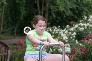Young girl playing in a park - Kelleher Photography Store