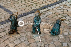 Wroclaw, Poland – March 4, 2018: Wroclaw, a miniature statue of a gnome on the main square of the city. - Kelleher Photography Store