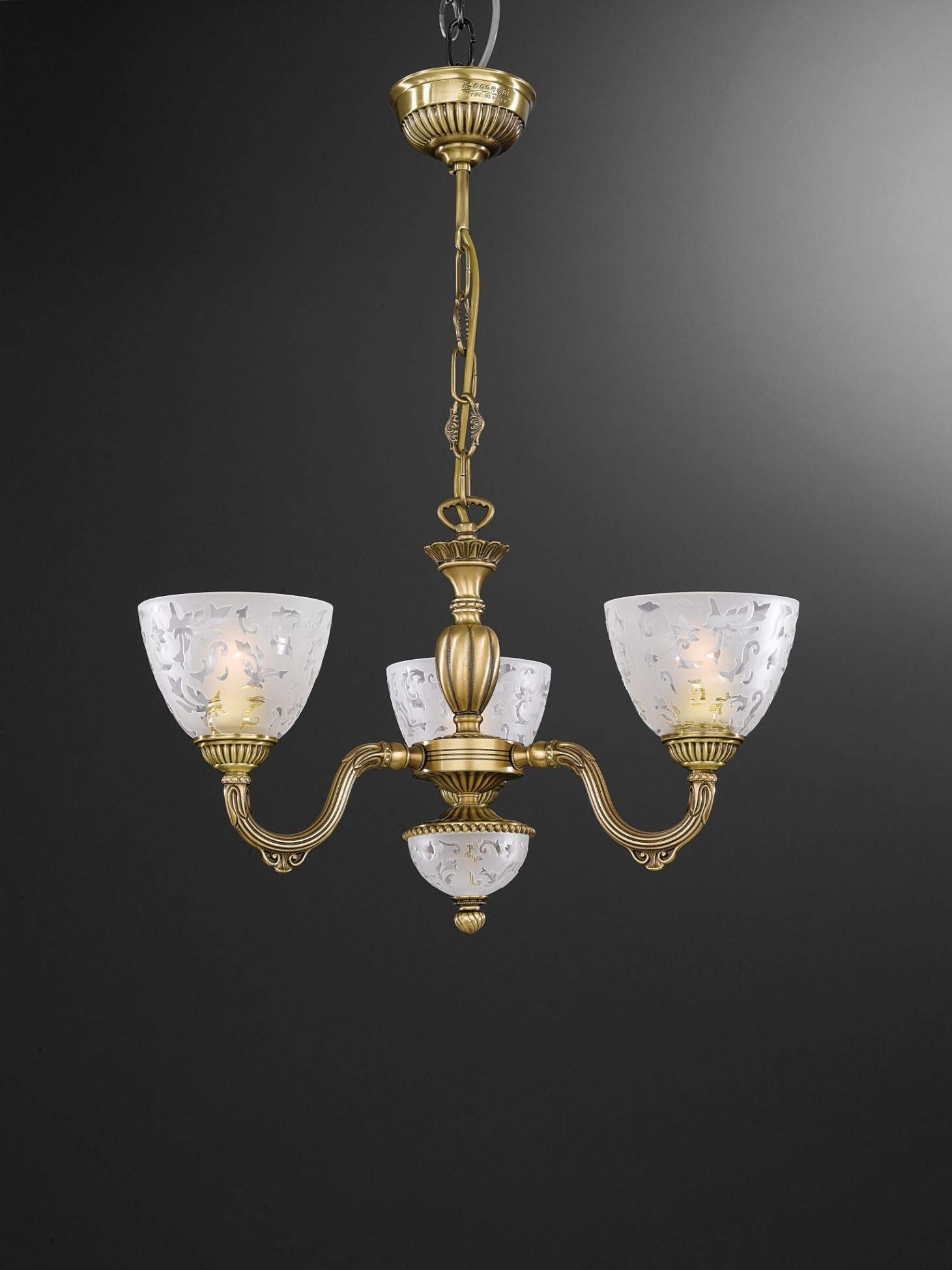 3 light brass chandelier with frosted glasses facing