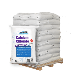 50lb bag of Calcium Chloride Flakes in front of pallet