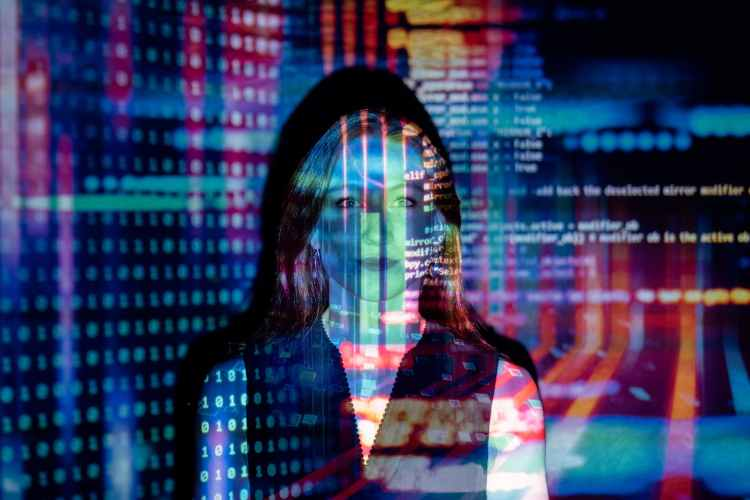 photo of code projected over woman. Welcome to The Future