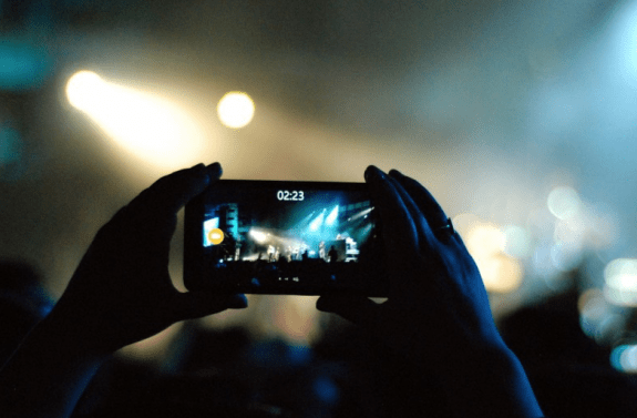 Cell phone taking a video at a party