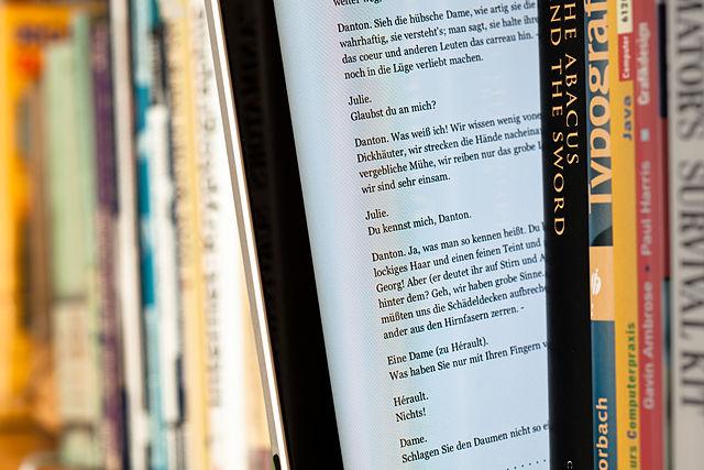 640px-EBook_between_paper_books