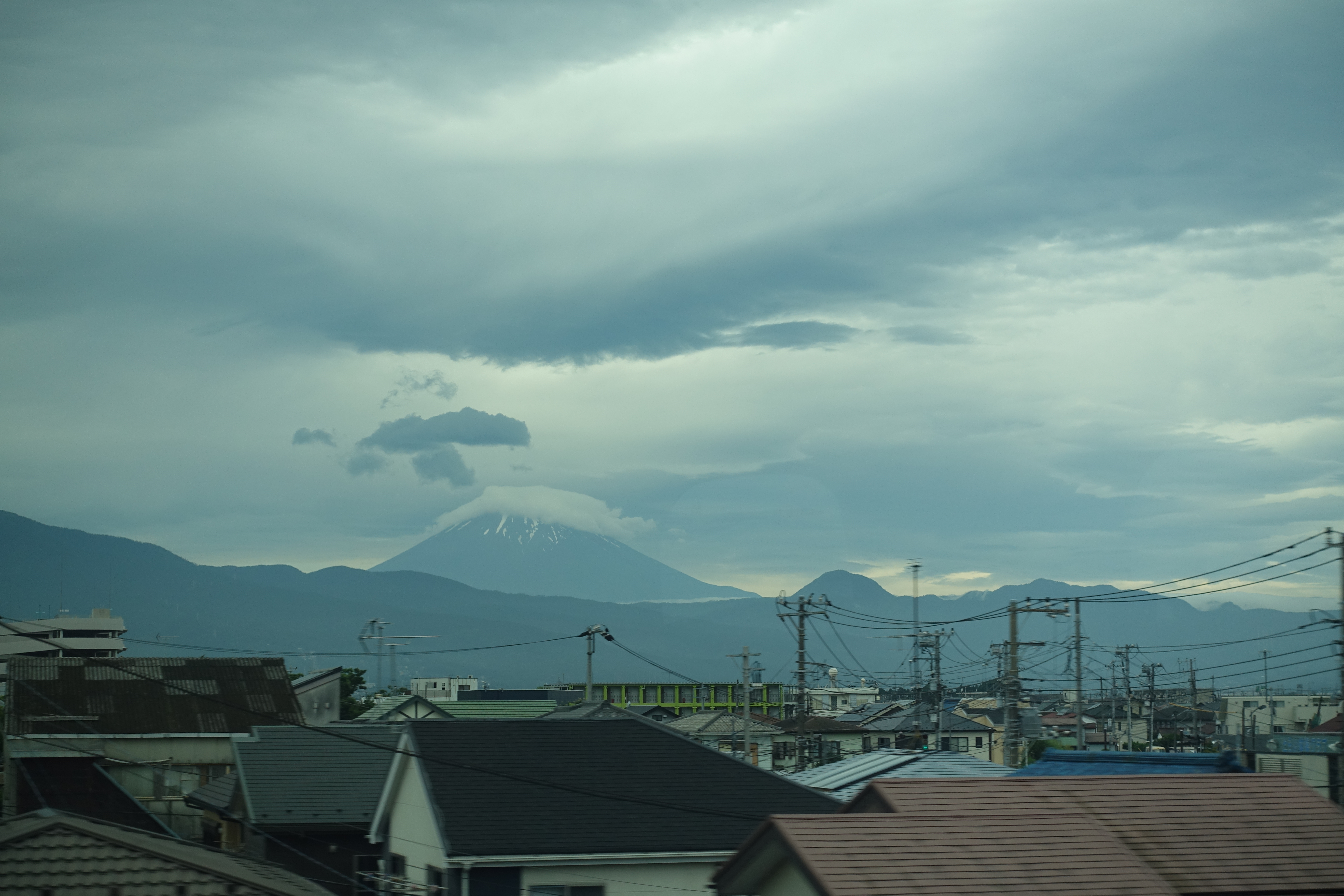 Mount Fuji behind houses