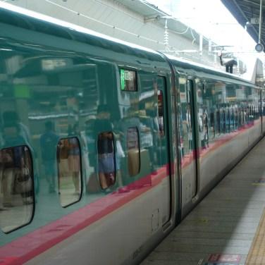 A Hayabusa Shinkansen at the platform
