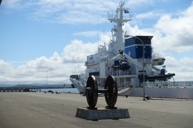 Railway wheels in front of a ship