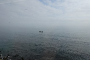 A lone fishing boat on the sea