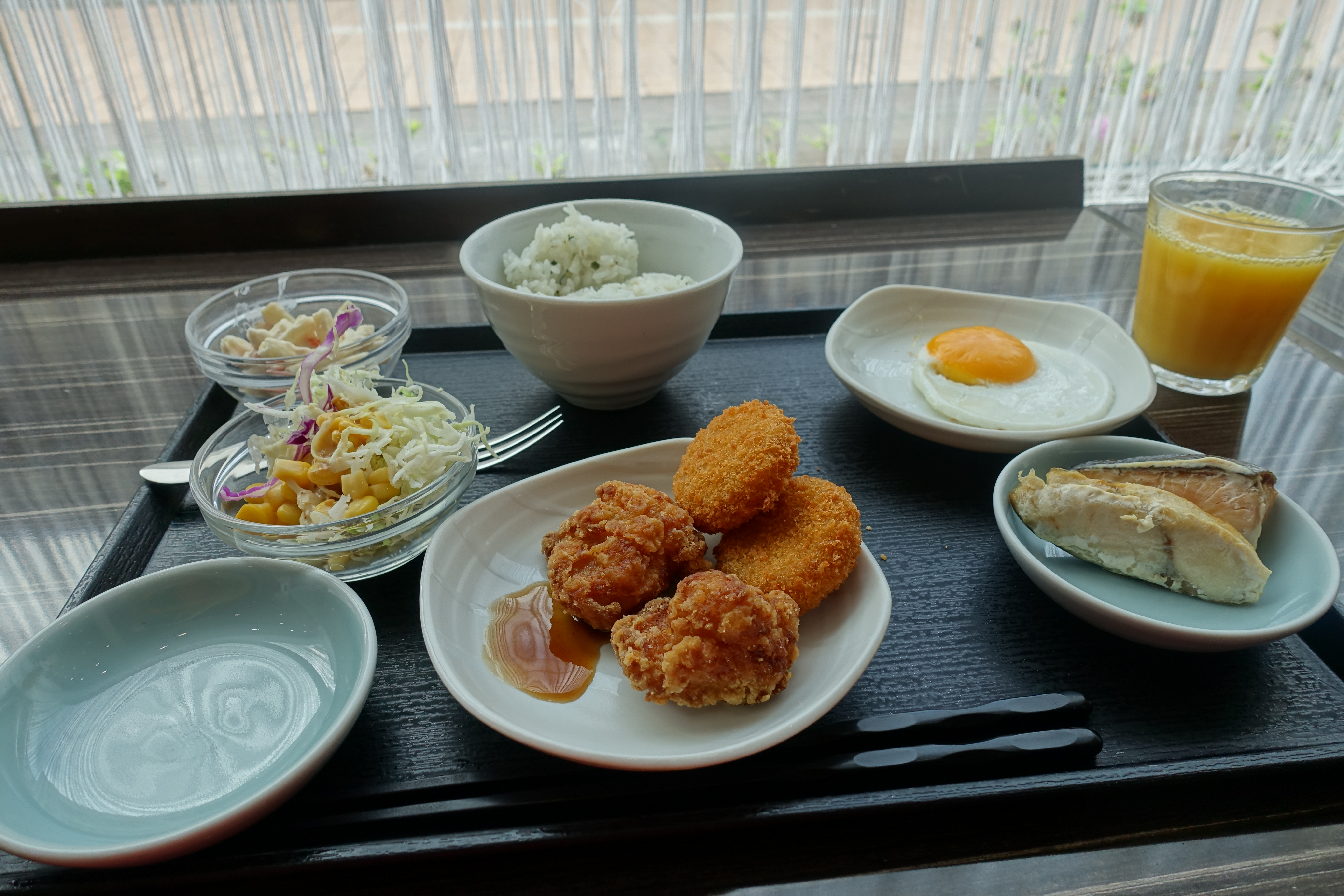 Fried chicken, salad, egg and fish
