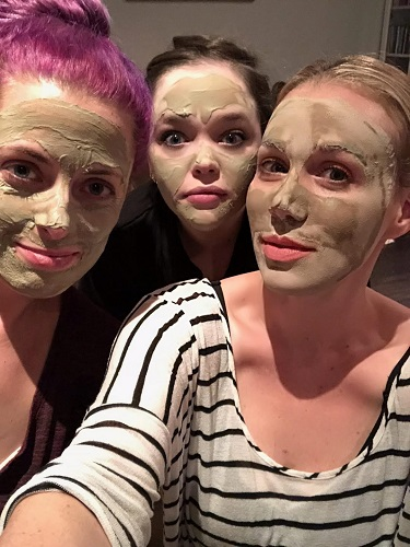 Women with facial mud masks
