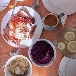 The pork roast with pickled cucumber and pickled red cabbage