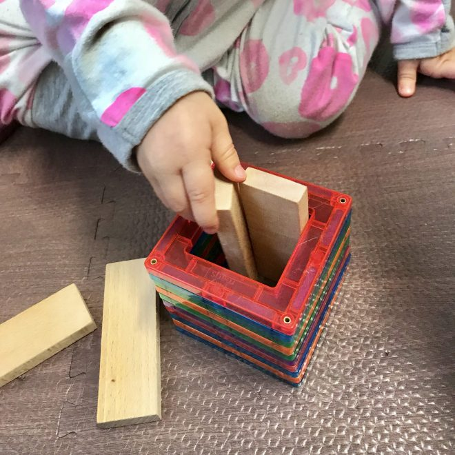 1 year old playing with magnetic tiles