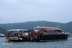 Big Boat with hundred passengers in Sama Bay