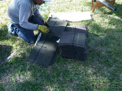 Allen roofing contractor working on shingles