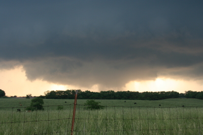 Wall cloud with clear slot wrapping in.