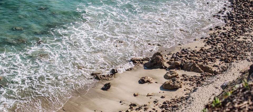 Ocean crashing gently onto the shore.