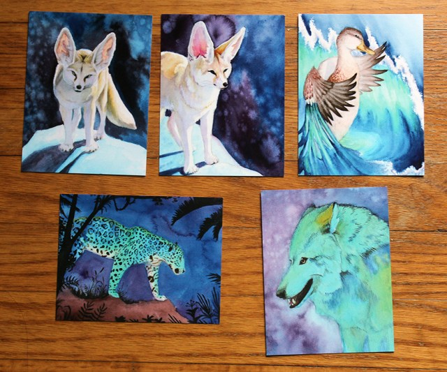 A set of 5 watercolor postcard prints featuring wolves, foxes, a jaguar and a duck.