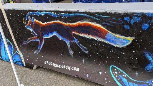 Photo of jersey barrier murAL OF RUNNING FOX