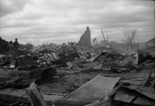 Rescuers search for victims in the rubble of brick buildings totally destroyed by the tornado and fire.
